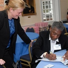 Barbara Hillary gives an autograph